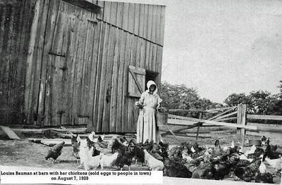 Louisa Bauman feeding chickens 1929