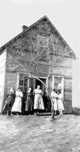Dora Wheeler, wife of Walt Wilcox, Unknon, Eugenia Wilcox at her house in Flandreau, SD, , Unknown, Martha wife of Ed Wilcox