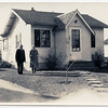 Curtiss and Huldah Conrad in front of ? house