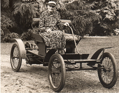 Margaret Dill Wittman on an early car