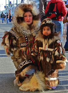 A native woman and her son. Beautiful hand made fur coats.