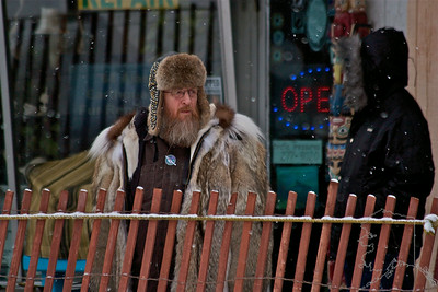2012 Fur Rondy Sprint Dog Races in Anchorage. This is a world class dog race with competitors from all over the world come to race there dogs.  Alaskan mountain man.