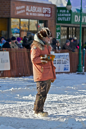2012 Fur Rondy Sprint Dog Races in Anchorage. This is a world class dog race with competitors from all over the world come to race there dogs. The man in charge of the starting of the race.