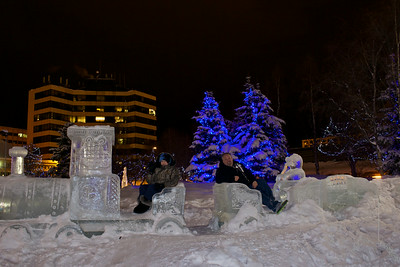 The Ice Sculptures in Anchorage this yesr. These are built by local artists every year around Fur Rondy time.  Donnette and I sitting on the Ice train. It was about 12 degrees and about 2 am in the morning.