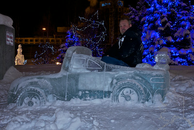 The Ice Sculptures in Anchorage this yesr. These are built by local artists every year around Fur Rondy time.  Me sitting in an Ice car. It was about 12 degrees and about 2 am in the morning.