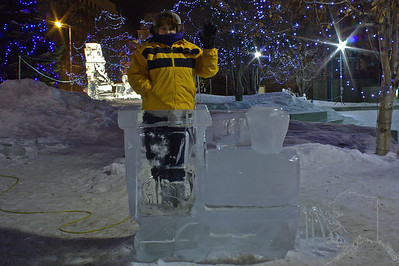 Every year Anchorage has a ice carving contest. Donnette standing in an ice train.