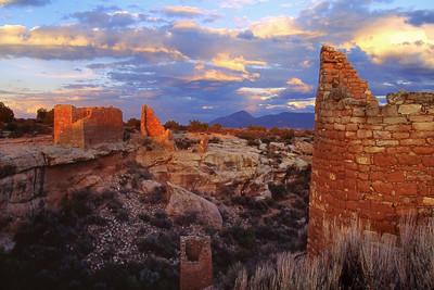 Hovenweep Castle summer sunset.  Sleeping Ute Mountain on horizon.