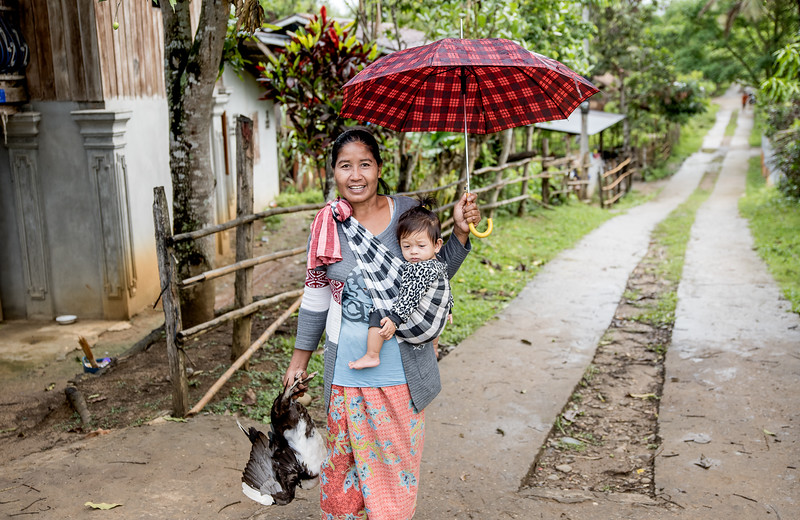 Village woman coming home  from market in Ban Tin Kaew,  Laos.