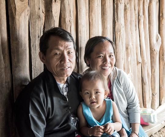 Hmong man and family.