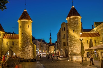 Entering Tallinn, Estonia's Old Town, the two towers of the Viru gate on the east side of the town's wall, with a view toward the spire of the town hall. The town dates from the 1100s.