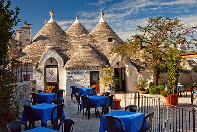 A trullo (plural trulli), a traditional dry-stone house common in Apulia, Italy. This trullo in Alberobello has been converted into a restaurant.