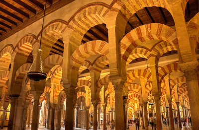 Inside the Mosque-Cathedral in Cordoba, Spain. It was built by the Moors beginning in the 8th century, but was converted to a Christian Cathedral in 1236 during the Reconquista. Much of the beautiful Moorish architecture was left in place.