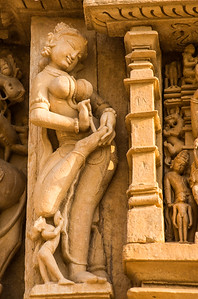 Lady extracting a thorn from her foot, south side of Parsvanath Temple, Eastern Group, Jain Enclosure, Khajuraho, India.