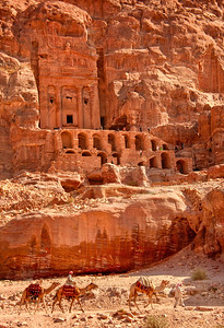 Royal tombs carved into the rock in Petra, Jordan. Petra was founded by the Nabataeans as early as the 4th century BCE. Note the scale of the people on the upper level.