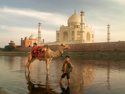 The exquisite Taj Mahal in Agra, India. It was commissioned in 1632 by the Mughal emperor Shah Jahan to house the tomb of his favorite wife, Mumtaz Mahal. Construction of the Taj and surrounding buildings employed some 20,000 artisans.