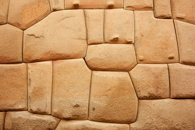 Macchu Pichu and other Inca sites are famous for their extremely tight-fitting stonework. This is part of the wall at Sacsayhuaman just outside of Cusco, Peru.