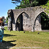 Michelle studies the ruins of Armagh Franciscan Friary in County Armagh.