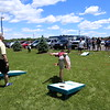 Crazy corn hole thrower