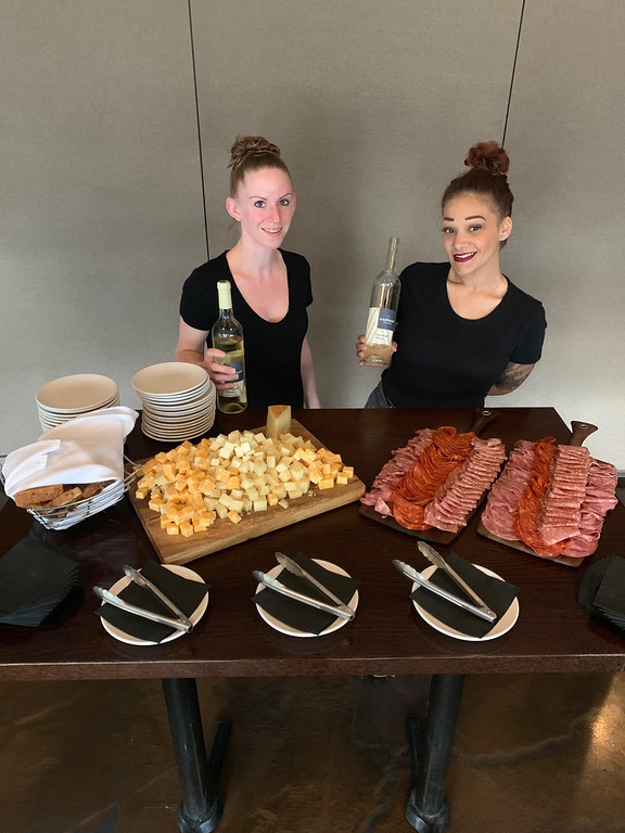 . Andiamo�s Becky Thibedore of Chelmsford and Fatima Kolpachnikoft of Billerica serve up Salumi E Formaggi paired with a 2017 Stonewall White