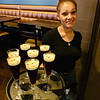 The beautiful Fatima Kolpachnikoft of Billerica holds a platter of Andiamo's famous Dolci Dessert Martini