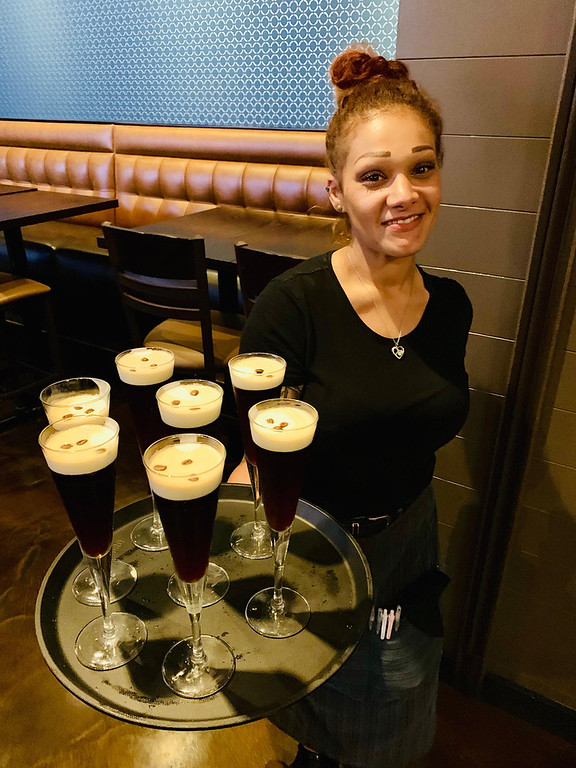 . The beautiful Fatima Kolpachnikoft of Billerica holds a platter of Andiamo�s famous Dolci Dessert Martini
