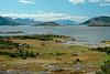 Skarstad i Efjord i Ballangen kommune. Rett frem Revelsøya. Til høyre deler av Barøya. Lengst bak fjellene i Hamarøy.