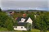 Kiruna, sommer 2008. Bolighus i Kiruna. Foto fra ca Ripan. I bakgrunnen vindmøllene som ligger utenfor byen, på vei mot Narvik.