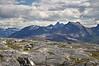 Utsikt fra Skarstadtoppen i Efjord i Ballangen kommune. Midt på i bakgrunnen Stetind (tverr på toppen), og til høyre fjellformasjonen Kuglhornet.
