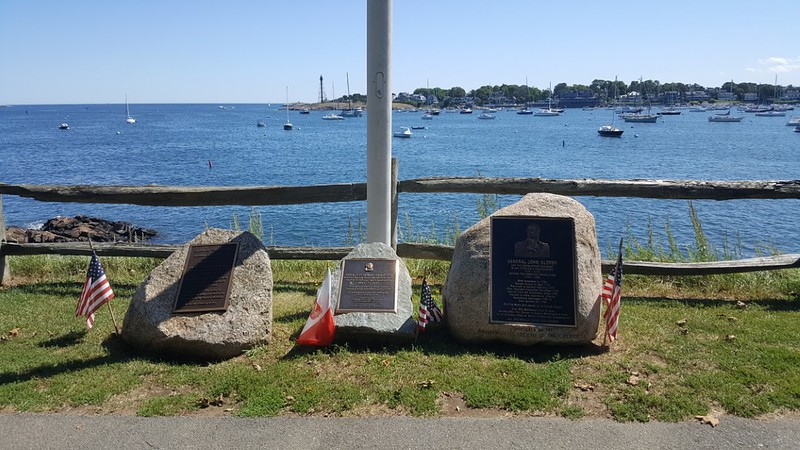 The monument on the right was erected in 2011 to honor Marblehead native Gen. John Glover. It is set in Fort Sewall Park, which overlooks the harbor entrance. The Park is located at 8 Fort Sewall Ln, Marblehead, MA.
