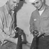 1953 Richard Andres and Chief Witt with their antique guns on the USS Piedmont