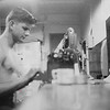 Richard Andres at work aboard ship.  USS Piedmont 1952
