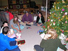 Nathan and Alex, Sarah, Dad, Rachel, and Mom opening presents Christmas morning