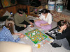 Sarah, Nathan, Alex, and Rachel playing the game of Life