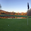 Golf course putting green in New Hampshire USA with golf ball and flagstick