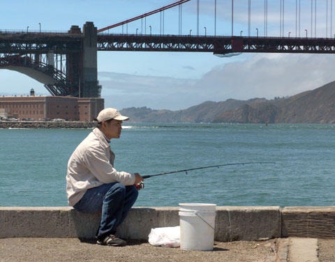 The fisherman<br /> Just one of the several people fishing off Torpedo Wharf. Later I spotted him talking on his cell phone!