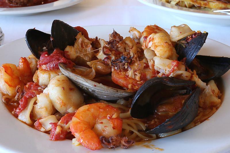 The Frutti di Mare has sautéed scallops, clams, Haddock, shrimp, mussels and calamari in a Marinara white wine or fra diavolo sauce over linguini at Angelina's Italian Restaurant in Tewksbury. SUN/JOHN LOVE