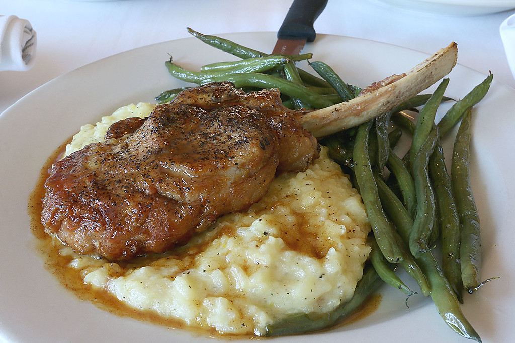 . The Veal Chop pan seared and topped with vermouth pan sauce, served with cheese risotto and a daily vegetable at Angelina\'s Italian Restaurant in Tewksbury. SUN/JOHN LOVE