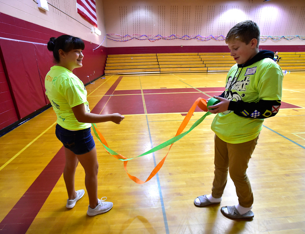 . LAFAYETTE, CO - AUGUST 15, 2018  Gianna Rodriguez, left and Sully Cox struggle to figure out how to make streamers as the eight graders decorate the gym to welcome the school\'s new students during the first day of classes for sixth graders at Angevine Middle School in Lafayette on Wednesday August 15, 2018.  (Photo by Paul Aiken/Staff Photographer)