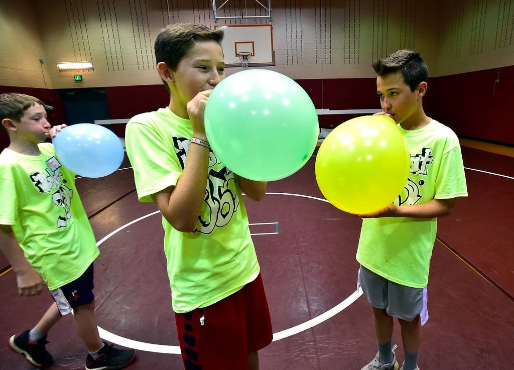 . LAFAYETTE, CO - AUGUST 15, 2018  Eight graders Jack Carlson and J.D. Jutting, right, blow up balloons for a game the sixth graders will play as their class prepares a welcome for the new students during the first day of classes for sixth graders at Angevine Middle School in Lafayette on Wednesday August 15, 2018.  (Photo by Paul Aiken/Staff Photographer)