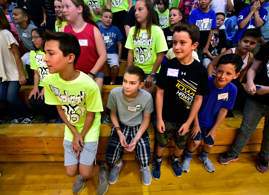 . LAFAYETTE, CO - AUGUST 15, 2018  From left to right eight grader J.D. Jutting, and sixth graders Cooper Perrine, Carson Jutting and Tavian Gomez play a sitting and standing game with the school during the first day of classes for sixth graders at Angevine Middle School in Lafayette on Wednesday August 15, 2018.  (Photo by Paul Aiken/Staff Photographer)