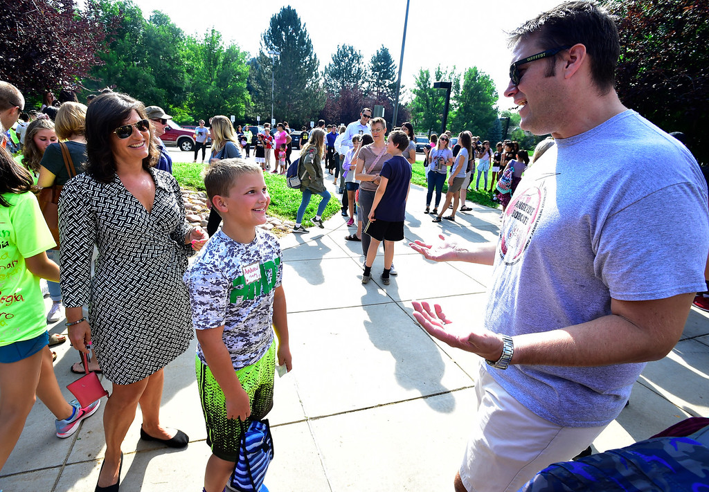 . LAFAYETTE, CO - AUGUST 15, 2018 Sixth grader Andrew Murphy gets ribbed by teacher Jed Cook for looking just like Murphy\'s older brother who Murphy has taught as the school welcomed their new students during the first day of classes for sixth graders at Angevine Middle School in Lafayette on Wednesday August 15, 2018. Andrew\'s mom Michelle was escorting him to school (Photo by Paul Aiken/Staff Photographer)