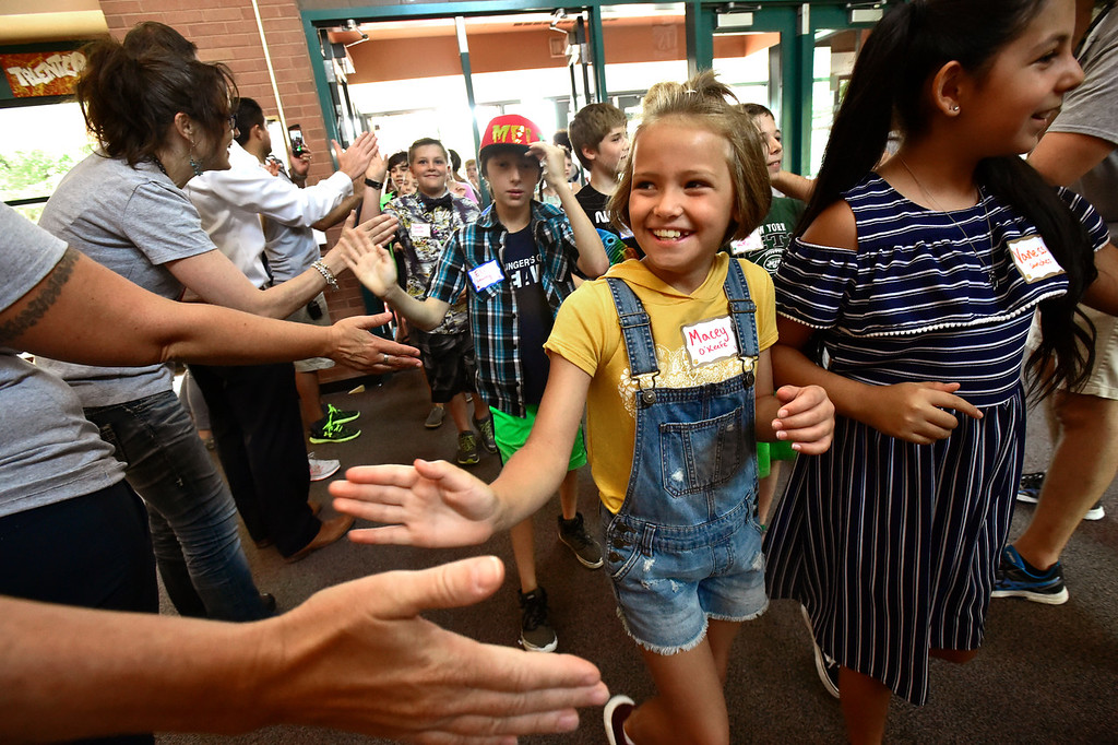 . LAFAYETTE, CO - AUGUST 15, 2018 Sixth grader Macey O\'Keefe gets welcomed by a tunnel of teachers during the first day of classes for sixth graders at Angevine Middle School in Lafayette on Wednesday August 15, 2018.  (Photo by Paul Aiken/Staff Photographer)