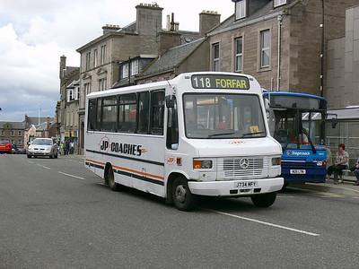 J P Minicoaches Forfar J734MFY E High St Forfar Jul 09