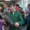 Animal Adventures out of Bolton visited the Fitchburg Public Library on Friday, Dec. 27, 2019 with some of their animals. Mikkel Torgersen, 6, from Lunenburg holds an American alligator during Animal Adventures visit. SENTINEL & ENTERPRISE/JOHN LOVE