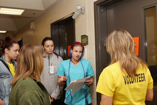 Volunteers meet to discuss shifts and duties
