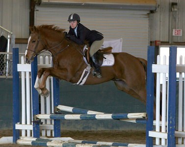 Berry College student Sarah Smith rides in the Equitation Over Fences Class and finishes 4th.