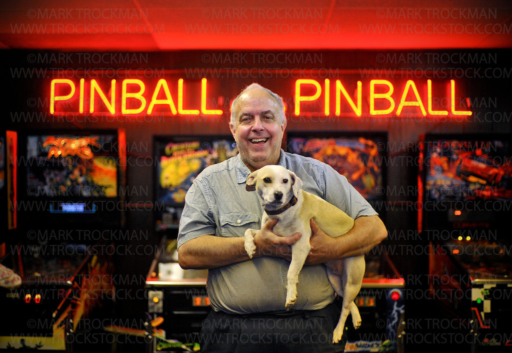 Pinball Wizard.  S.S. Billiards owner Lloyd Olson and his trusted companion Prada inside his Hopkins business Saturday, Oct. 27, 2012.  Olson has owned and operated the pinball, pool, and video game emporium for 40 years.  Olson and Prada marked the anniversary with a pinball championship tournament.