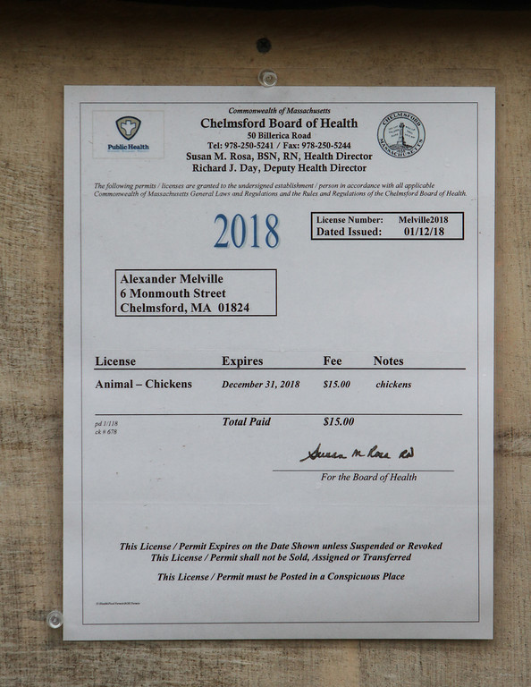 . The now expired Board of Health permit on Alexander Melville of Chelmsford\'s family\'s chicken coop. Under new town regulations, they face costs including $1,500-2,000 for a plot plan. (SUN/Julia Malakie)