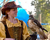 Leanne Betts and her red tail hawk, Helio