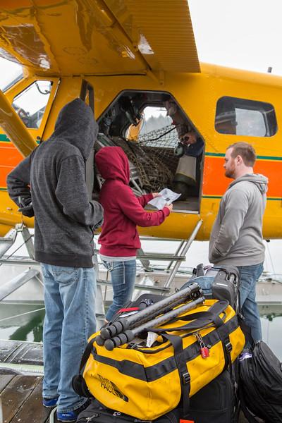 Loading camera gear into float plane